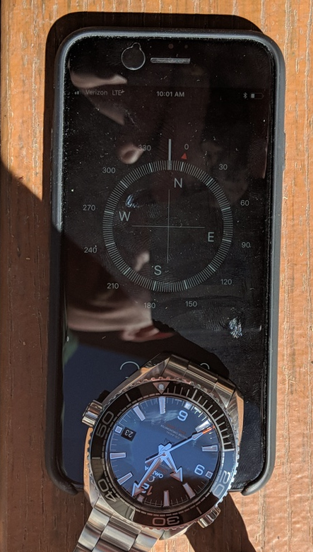 Comparing Watch And Compass
